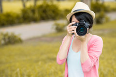 Photo of you. Copy-spaced image of a female photographer making a photo of you on the foreground stock images