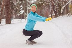 Photo of young athlete girl on morning exercise in winter. stock photo