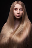 Photo of young beautiful woman with long hair Royalty Free Stock Image
