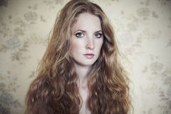 Photo of young beautiful woman with red curly hair Stock Photo