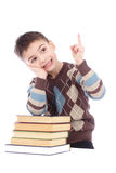 Photo of young boy with books showing finger up Royalty Free Stock Photography