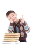 Photo of young boy with books showing finger up Stock Image