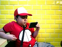 Young boy using a smart phone stock photo