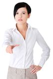 Photo of young businesswoman greeting you Royalty Free Stock Images