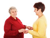 Elderly woman and young caregiver. Photo of young caregiver holding elderly women hands Stock Photos