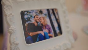 Photo of young couple in the frame. Photo of young happy couple in the frame. Decoration of the table stock video