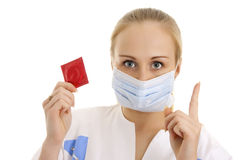 Photo of young doctor with condom. Stock Photography