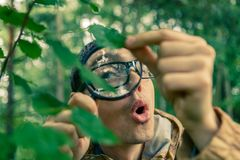 Photo of young ecologist with magnifying glass Stock Photography