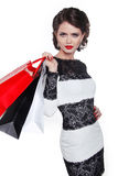 Photo of young elegant woman with shopping bags  isolated on whi Royalty Free Stock Photography