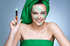 Photo of young girl in green towels with flawless skin royalty free stock image