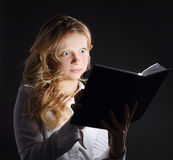 Photo of young girl reading book Stock Photography