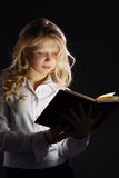Photo of young girl reading book Royalty Free Stock Photo