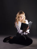 Photo of young girl reading book Stock Photo