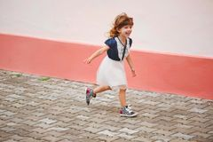 Young happy girl running away stock images