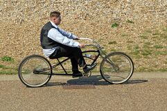 Jewish boy riding customised cycle