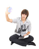Photo of young man holding a cd dvd isolated Stock Image