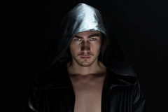 Photo of the young man in hood Stock Photo