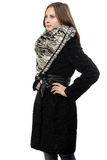 Photo of the young serious woman in fur coat Royalty Free Stock Images