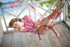 Photo young sexy girl relaxing on beach Bungalow in hammock. Smiling woman spending chill time outdoor summer. Caribbean. Ocean Vacations. Horizontal, blurred Stock Image