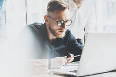 Photo young and talente finance manager working with new project. Team job. Analyze business plans on laptop. Blurred Stock Photos