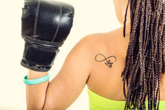Photo of young woman from behind showing black boxin Stock Photos