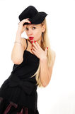 Photo of young woman in a black dress with the hat Royalty Free Stock Images