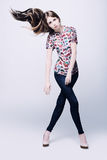 Photo of a young woman in blue jeans. Studio photo of the girl in casual clothes Royalty Free Stock Images