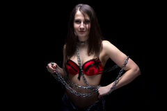Photo of young woman in bra with chain Royalty Free Stock Image