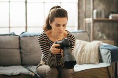 Photo of young woman with brown hair using dslr photo camera Royalty Free Stock Photography