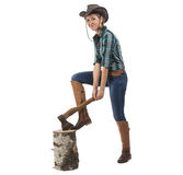 Photo of young woman chops wood Royalty Free Stock Photography