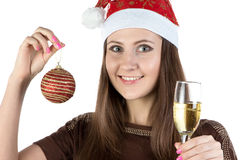 Photo of young woman with christmas ball and glass Royalty Free Stock Photos