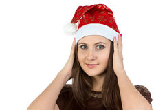 Photo of young woman correcting her hat Royalty Free Stock Photo