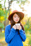 Photo of  young woman with cup of coffee standing in th Royalty Free Stock Photo