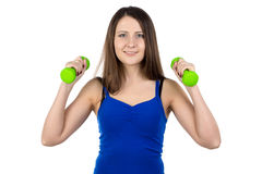 Photo of young woman with the dumbbells Royalty Free Stock Images
