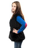 Photo of the young woman in fake fur waistcoat Royalty Free Stock Images