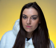 Photo of the young woman in fur coat Stock Images