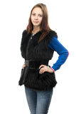 Photo of the young woman in fur waistcoat Stock Photography