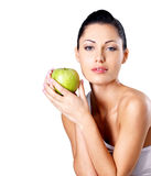 Photo of a young woman with green apple. Stock Photo