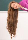 Photo of young woman with long hair. Stock Image