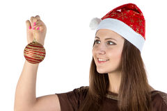 Photo of young woman looking at christmas ball Royalty Free Stock Photos
