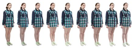 Photo young woman during pregnancy in plaid shirt. Caucasian woman during pregnancy in plaid shirt on white background stock images