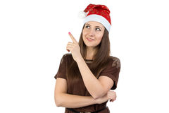 Photo of young woman showing something in xmas hat Royalty Free Stock Photography