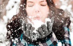 Photo of a young woman in the snow Royalty Free Stock Photography