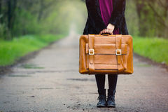 Photo of young woman with suitcase Royalty Free Stock Photos