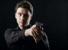 Photo yuong man with gun Stock Images