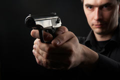 Photo yuong man with gun Stock Photo