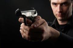 Photo yuong man with gun Stock Photo