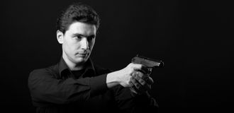 Photo Yuong Man With Gun Royalty Free Stock Images