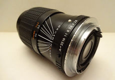 Photo zoom lens. Black photo zoom lens with adapter ring Stock Photo