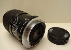 Photo zoom lens. Black photo zoom lens with adapter ring Royalty Free Stock Photo